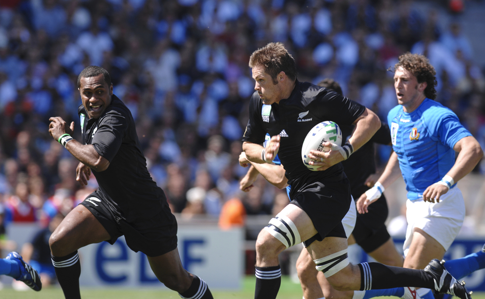 Richie McCaw carries the ball for the All Blacks